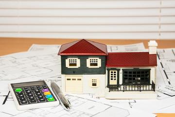 House model on construction blueprints