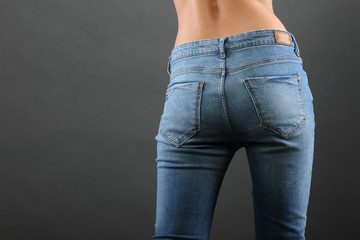 Female buttocks in jeans