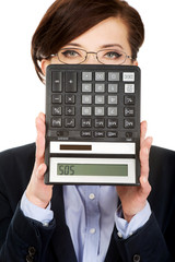 Businesswoman with SOS writing on calculator.