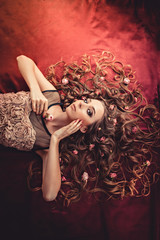 hair with roses expand on the fabric colored Marsala