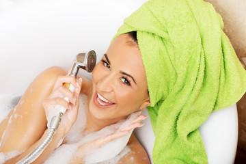 Woman having fun with showerhead