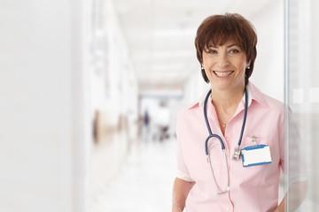 Senior female doctor in hospital smiling