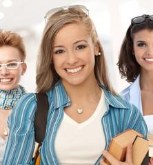 Group of happy student girls on school corridor