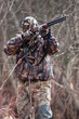 hunter in camouflage shooting from a gun - 81448246