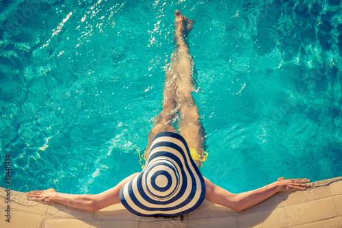 Plagát Young woman in swimming pool