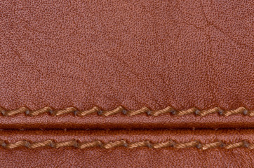 Brown stitched leather close up