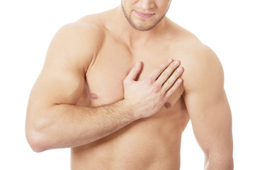 Athletic man feeling pain in his chest.