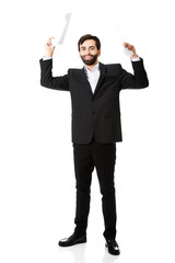 Happy businessman throwing paper sheets.