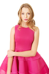 Young blonde woman with pink skirt