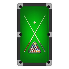 Billiards balls, triangle and two cues on a pool table.
