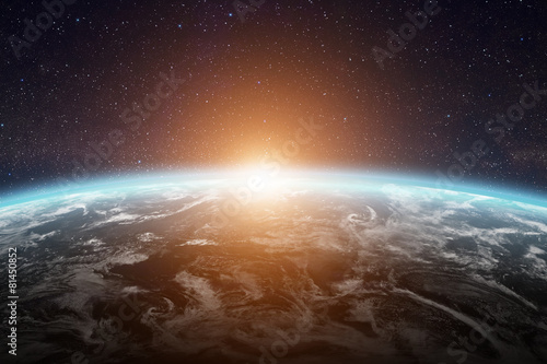 Sunrise over planet Earth in space - 81450852