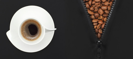 white cup of organic coffee on the background of black  paper