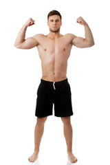 Young athletic man showing his muscles.