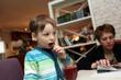 Boy tasting smoothies