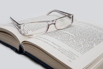 eyeglasses on the page of a book