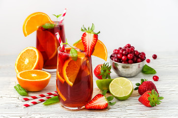 Refreshing summer drink sangria with fruits and berries