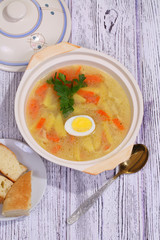 Chicken soup with house noodles and boiled egg