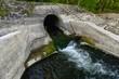 Leinwandbild Motiv Cooling water flowing into the river