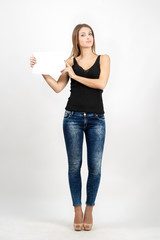 Confident woman holding blank white card