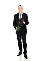 Smiling businessman with chainsaw