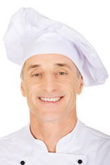 Chef in white uniform and hat