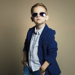 fashionable little boy in sunglasses.stylish kid in suit