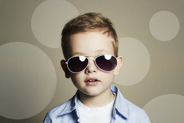 Funny child.fashionable little boy in sunglasses