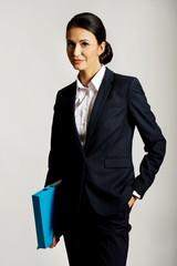 Businesswoman holding a binder