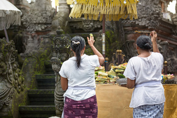 Two Asian woman praying in temple