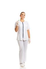 Female dentist holding a syringe