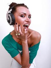 girl  in front of  camera in  DJ's earphones