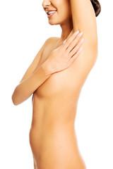 Beautiful spa woman touching an armpit