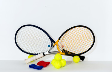 Tennis racket, ball, bandage