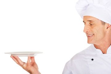 Chef holding white porcelain plate