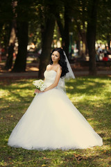 Adorable young caucasian bride in garden