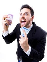 Happy young man holding Brazilian Money