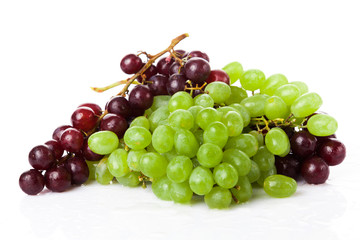 Black and white grapes isolated on white background