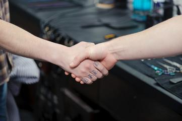 Strong firm handshake in barbershop