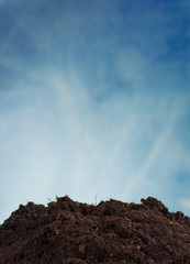 Pile of soil with blue sky background