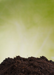 Pile of soil with green background