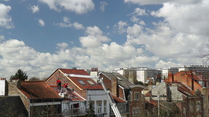 Workers covered foof tiles in Brussels. Time lapse.