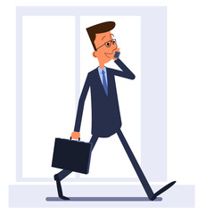 Businessman walking, holding briefcase and talking on the phone