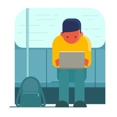 Man working on laptop in public transport