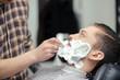 Client shaving at barber shop - 81462054