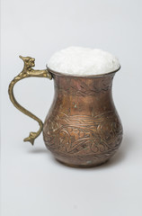 Turkish traditional drink ayran in copper cup
