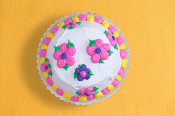 Iced cake with colorful flowers