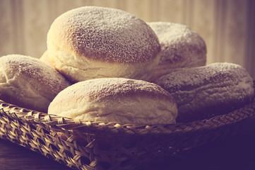 Closeup shot of doughnuts in wicker basket vintage effect