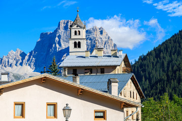 View of church in Pian village in Dolomites Mountains, Italy