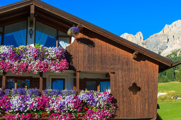 Alpine house in Cortina d'Ampezzo village in Dolomites Mountains