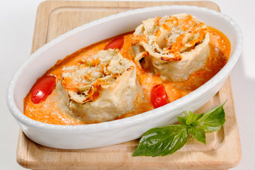Rolls with fish in tomato sauce